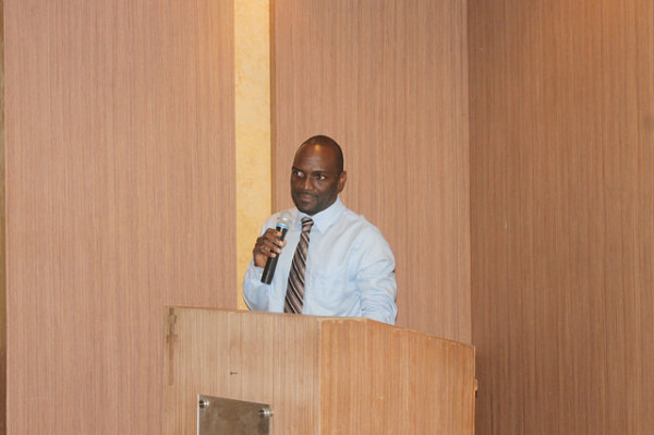 A Policy Analyst and Researcher at REPOA, Stephen Mwombela presenting a paper
