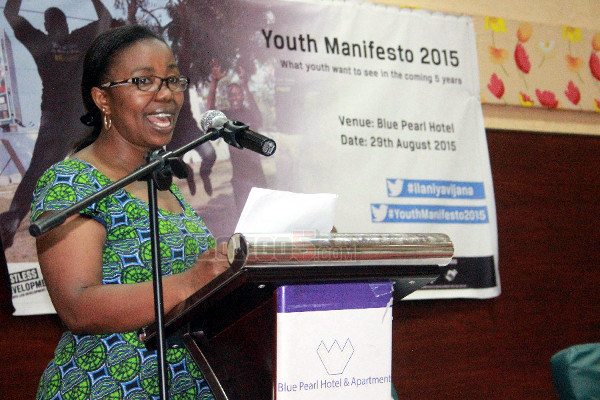 Country Manager for the Restless Development Ms. Margaret Mliwa addressing the youngsters
