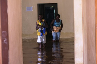 Search for safety - Workers of Baptist Compound in Bo Waterside finding their way out of the flooded building