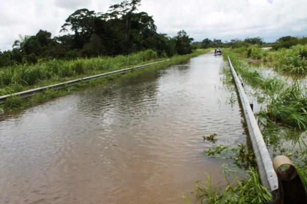 The main road overtaken by flood in Tewor District, Grand Cape Mount County