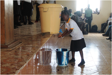 Demonstration of hand washing by a little female student