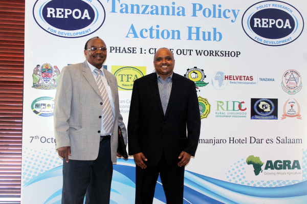L-R Executive Director REPOA Prof Samuel Wangwe and Research Analyst, AGRA-Liston Njoroge  posing a photo