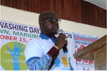 Margibi County Representative, Emmanuel Nuquay serving as Key-note speaker at Global Handwashing Day celebration in Margibi County