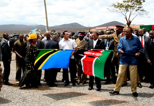 Flying the flags of their two countries are (L-R) President Jakaya Kikwete and Uhuru Kenyatta