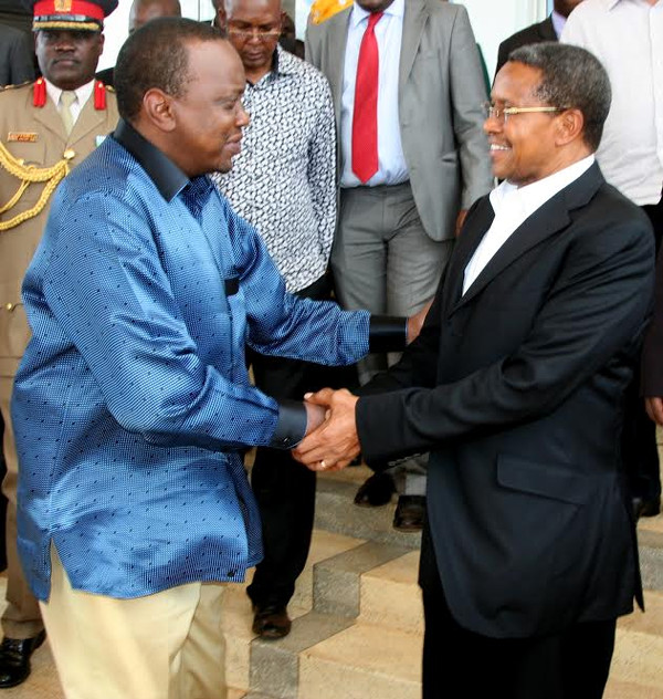 Uhuru Kenyatta inviting his guest Tanzania's President Jakaya  Kikwete during the official launching of road linking their two countries and for  Kikwete's biding fare ware after his end of the ten years in power