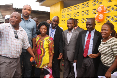 Representative Fahnbulleh, Assistant Minister Yarngo, Living Water Head Austin Nyaplue and other staff at the Duport Road Market latrine facility