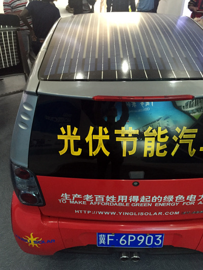 A car with its roof covered with solar panels for generating light it has been designed by the Yingli Solar in Hainan Province