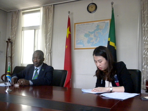 Ambassador Abdulrahaman A. Shimbo on his left is an interpreter during an interview Ms. Zhang Xuan