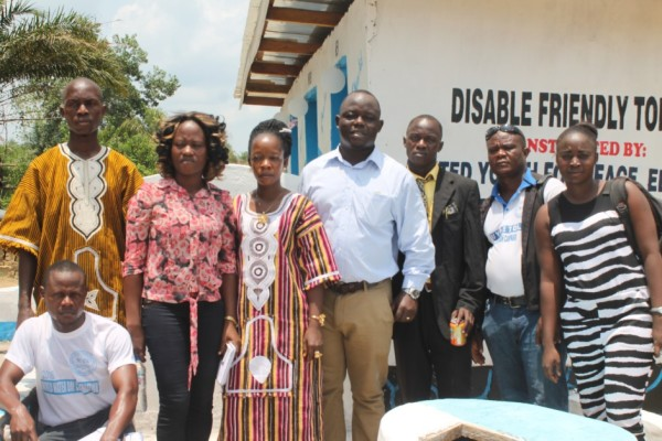 Staff of UYPETDL posting with WaterAid Team Leader and Policy Officer