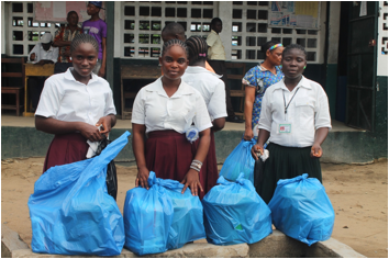 Some of the female students with materials given them as part of the importance of Menstrual Hygiene Management