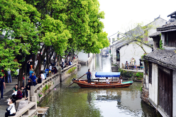 Thousands of domestic tourists are visiting sites like this former residence of the Ching dynasty at the China Water Town of Zhouzhuang