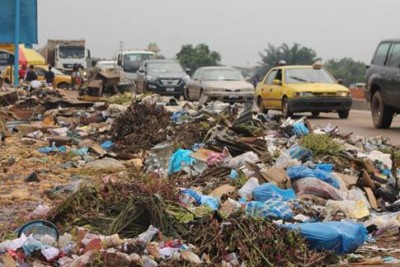 Garbage taking over the main road at Jacob's Town, Paynesville