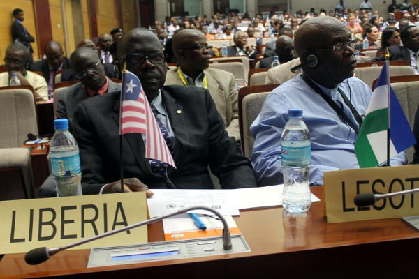 Liberia represented by Deputy Public Works Minister, Jackson Paye, and Assistant Minister George Yarngo (seated at the back with glasses)