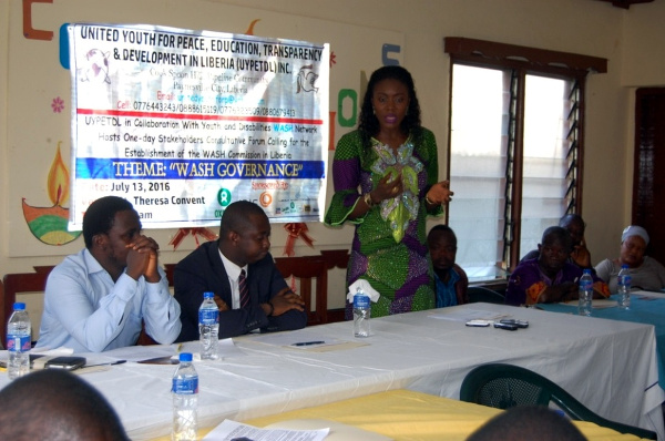 Montserrado County Representative, Munah Youngblood speaking  at a one day forum before the signing of the WASH Commission Act