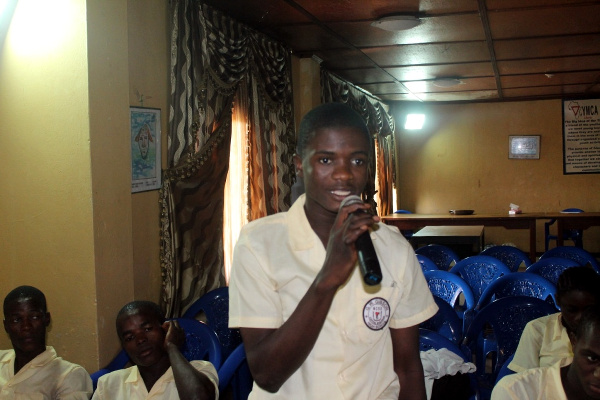 A student asking question about the production of mineral water in the country