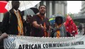 Amaha Kassa -2nd left-, founder and Executive Director of African Communities Together leads a rally to Save TPS under drenching rain outside US Immigration building at Federal Plaza in downtown New York City