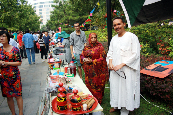 Sudanese national and Editor Mr. Mohamed Abdelaziz, his wife Mrs Mwahib and a journalist from Egypt Mr. Hani Kamel Mohamed represented the China-Africa Press Centre (CAPC), Pavilion through cuisine from Sudan and other small items