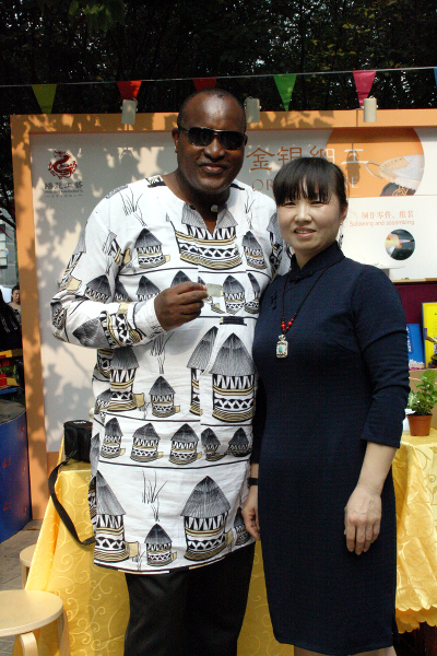 This reporter attracts an attention of a Chinese lady who was fascinated by attire which was designed at the Afrika Sana, a home of African designs in Tanzania