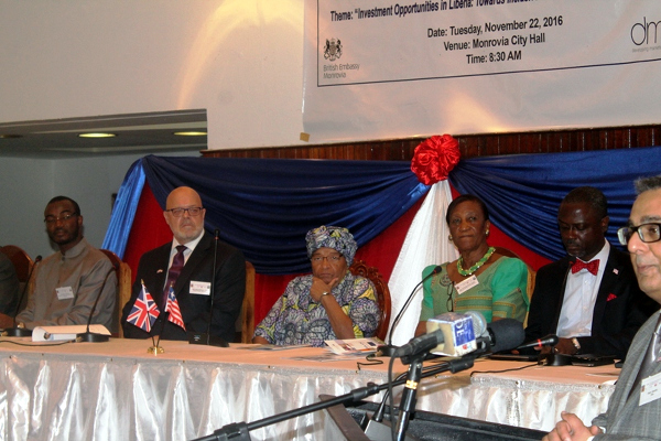 Pres. Sirleaf, the British Ambassador and other Dignitaries on the Platform, as DMA CEO Atam Sandhu during the Forum