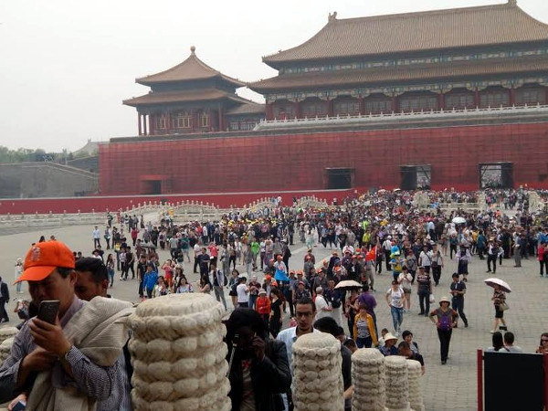 """Visiting the Palace Museum in Beijing also known as the """"Forbidden City"""" former emperor's residence during the Qing dynasty"""