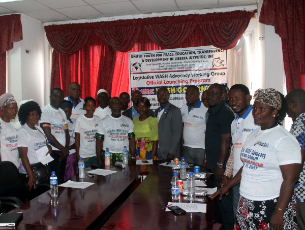 """Group photo following the official launch of the Legislative WASH Advocacy Network,  also, known as """"Champions of WASH"""""""