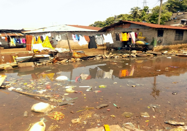 Flood, garbage and feces becoming a health threat for Slipway residents this raining season