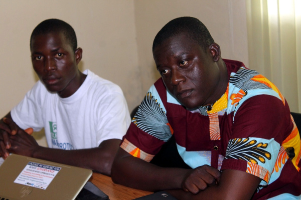 United Youth Executive Director, Timothy Kpeh and a resident of Clara town swamp community, Asumana Dukuly