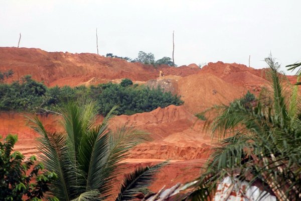 Environmental threat KBL piling up dirt from mining activities with town beneath the dirt pile
