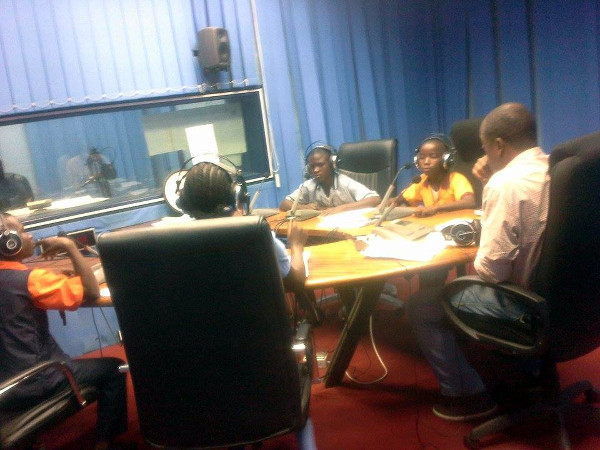 Students in Monrovia discussing the importance of handwashing, as part of Global Handwashing Day on the United Nations (UNMIL) Radio