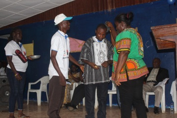 Living Water Int'l Country Director, Austin Nyunplue honored by one of the schools for his efforts on WASH
