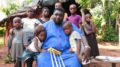 PAULCY-IWUALA with a homeless family in Mbaise, in Imo State, Southeast Nigeria that he built a two bedroom apartment for to ameliorate their sufferings